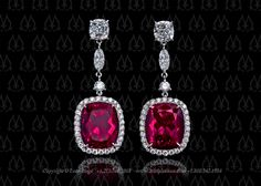 Custom made halo earrings, featuring total of 9.59 carat cushion red tourmalines.