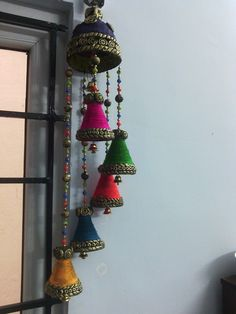 wind chimes of small coca-cola bottles