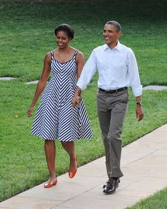 President Barack Obama and First Lady Michelle Obama (dress by Talbots) make their way to the Congressional Picnic on the South lawn of the White House, June 15, 2011.