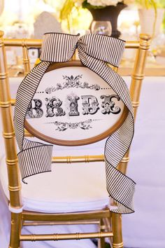Make the bride's designated chair beautiful with ribbon and a lovely sign.