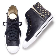 """Www.youravon.com/mzsheshe Just for kicks! Our favorite part of the athleisure trend: studded old-school high-tops. Oh, what fun! Black faux-leather shoe with white toe tip and outsole; white trim along bottom with a thin, black line running through; bronze eyelets, side zipper for easy on/off and studs in back; metallic gold interior lining. 1"""" rubber sole. Half sizes order up."""