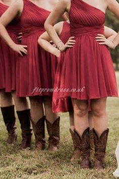 bridesmaid dresses in red are perfect and the cowgirl boots just make it even better!! I LOVE IT <3