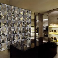 Wall-mounted modular polygon facets in mirror composite. Dimensions Shown: 3000 x 3000mm / 10' x 10' Materials Shown: ACM, MDF
