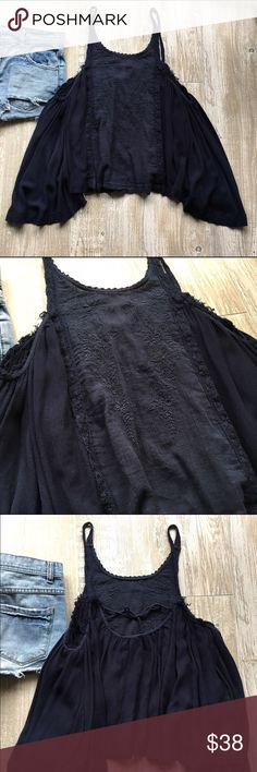 •Free People• Navy Embroidered Tank Truly a beautiful tank! Great for pairing with high waisted shorts during festival season. Layer it with a cardigan in the fall and winter for a cozy, but still pretty look. Throw on a floppy hat and you're set!! Only worn a handful of times and is in great condition. Not a piece to miss! Size Small, but because of billowing nature could easily fit an XS or Medium as well. Free People Tops Tank Tops