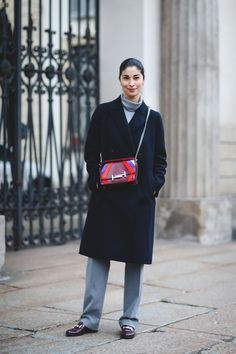 70+ Photos Of Milan's Most Over-The-Top Street Style #refinery29 http://www.refinery29.com/2016/03/104781/milan-fashion-week-fall-winter-2016-street-style-pictures#slide-24 Look to Caroline Issa's polished look for an example of how to do business casual without feeling stuffy....