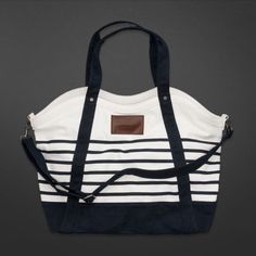 cddaef891721 Check out Abercrombie   Fitch Women s Accessories to find the cutest Totes  to carry your books in style. Plus