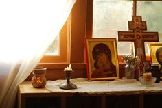 This is a beautiful picture of a beautiful place: one family's icon corner.  I love it.