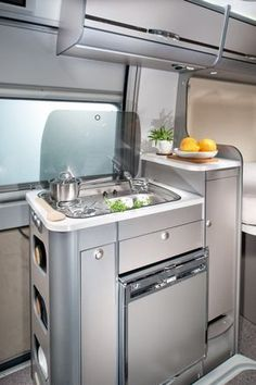 Compact camper van kitchen #MinimalistHomeAppliances