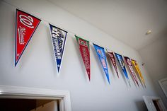 Love this idea to hang all of Mark's pennants instead of tacking them to the wall.