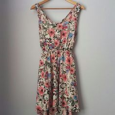 Spring fever!! Open back floral dress Gently worn -- excellent condition! 100% polyester. Lined. Shorter in front. Stretch waistband. Twist behind shoulders. Adorable spring dress!!  Bundle for best deals!! Hundreds of items available for discounted bundles- items starting as low as $5! You can get lots of items for a low price and one shipping fee!  Follow on IG: @the.junk.drawer Meeso Dresses High Low