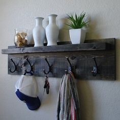 Handmade modern rustic coat rack with dark bronze hooks and floating shelf. Made from solid wood. It has been sanded down, then stained and sealed with Diy Coat Rack, Rustic Coat Rack, Coat Rack Shelf, Coat Hanger, Coat Racks, Diy Coat Hooks, Wall Hanger, Coat Hooks With Shelf, Entry Coat Hooks