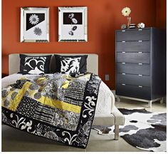 Modern Quilt  Giant blocks, each created from five large pieces, make this modern quilt a snap to complete. Black-and-white fabrics give the project a classic but edgy look. Love the paint color.