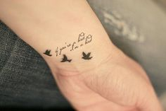 Very small lettering tattoo design with birds