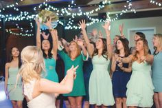 Bouquet toss! Click to see more from this Memphis wedding at Stonebridge Country Club with mint, baby blue and gold details! Image: Jon Sharman Photography | The Pink Bride www.thepinkbride.com