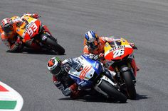 'Scuse me, coming through. Lorenzo and Pedrosa, probably at Valencia in 2013.