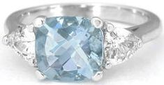 A classic three stone ring with a twist.  We used a cushion cut aquamarine ring with trillion white sapphire side stones. Found only at MyJewelrySource.