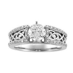 Celtic wedding ring... sweet since im irish lol I also saw in a Princess cut that is so beautiful