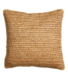 Cushion cover with braided paper straw at front, woven cotton fabric at back, and concealed zip. Size 20 x 20 in.