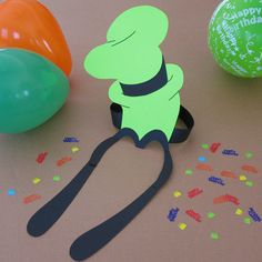Towering above Goofy's head, this bright green classic is great inspiration for a fun birthday party topper.