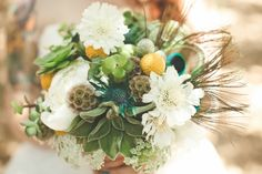succulent + white bouquet with peacock feathers from PixiesPetals.com // photo by VentolaPhotography.com