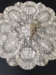 My choice for best lace from the 2/1/2015 Ebay Alerts. Point de Gaze parasol cover with heraldic elements.  Lots of great laces this week.