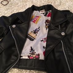 Black jacket kinda like a patent leather .  Girls Black patent leather like jacket Harajuku Lovers Jackets & Coats