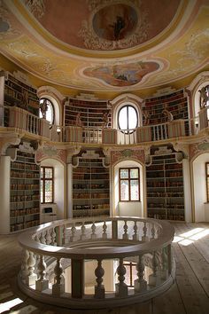 It's like the library in the Beast's castle in Beauty and the Beast.