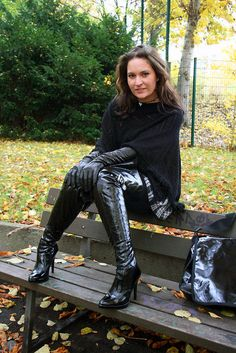 Awesome Woman In Black Boots And Gloves Sitting