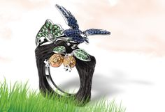 "Collection Name: Spring Miracle   Material Description: A Ring features a Sapphire, Fancy Sapphire and Wood in 18K White Gold by ""J Myths"" design concept."