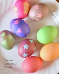 Easter Egg decorating using stickers to create a resist dye effect from Creative Connections for Kids