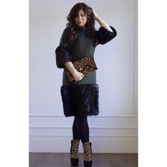 Green and leopard-print always go well together. Here, a wool Lim'ore number is styled with leopard-print accessories.