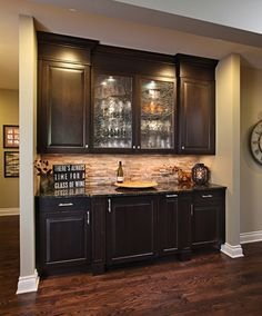 This dry bar is part of a kitchen remodel where the traditional cherry cabinets were replaced with espresso ones and custom leaded glass was made for upper cabinet doors. Yellow oak floors were refinnished and stained dark.