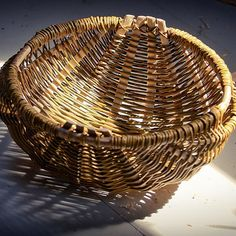 A Welsh frame (Cyntell) basket woven by Lorna Singleton with a hazel rim, willow rib and weavers.