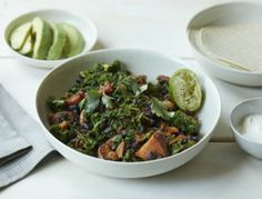 Cooked stovetop in one pan with aromatics, we top with a few slices of avocado and lime and green onions.  OMG!!! SO effing good!!!!  http://goop.com/recipes/sweet-potato-black-bean-kale-skillet/
