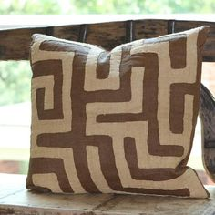 These large brown geometric Kuba-cloth pillows are all from one long vintage Kuba cloth appliquéd with natural wheat colored raffia. Backed in coordinating brown linen with french seams. Close inspect