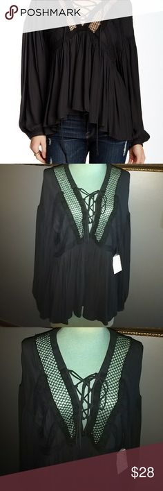 """Free People Shirt Black polyester with a V neckline in front has a lace up the front style and crochet design around the neckline has a high low hemline style has never been worn looser fitting style is 28"""" long great for layering Free People Tops"""
