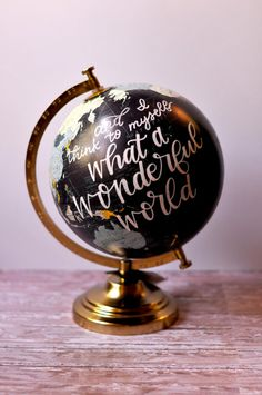 12.0 H x 9.0 W x 4.4 D Globe with brass base   This globe is made for adventurers and explorers! Beautiful calligraphy, hand written on top of an intricate and detailed map, this product is perfect for any home, office, nursery, or dorm room.    **TWO OPTIONS**  Standard-- The standard option comes with the quote seen above and I think to myself what a wonderful world.  Custom-- If you would like a custom quote, please select custom at checkout. In the message to seller options, write down…