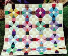 Maltese Circle - No curved pieces! All are straight edge. Pattern in Judy Martin's book Scrap Quilts 1986.