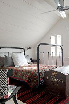 1940's, interior, attic bedroom, iron framed bed, rug, quilt, trunk, storage, vintage