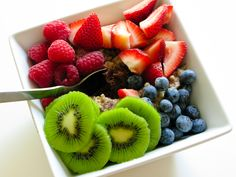 Oatmeal with Strawberries, Raspberries, Blueberries, Kiwi and Chocolate Peanut Butter