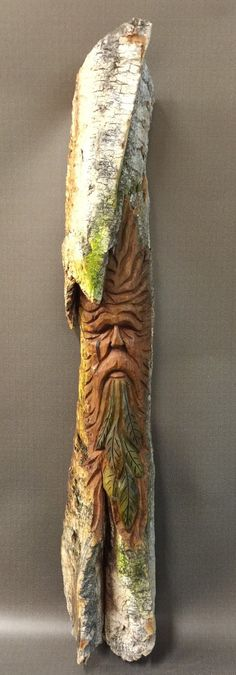 A personal favorite from my Etsy shop https://www.etsy.com/listing/267961749/hand-carved-original-green-man-wood