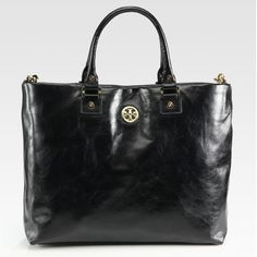 "LIKE NEW. Tory Burch 'Dena' Tote. Black. LIKE NEW. Comes w/ Tag and Receipt. Tory Burch 'Dena' Tote w/ Removable, Adjustable Strap. Buttery Soft Leather Crafted in a Roomy Logo-Embellished Silhouette. Double Top Handles, 5.5"" Drop. Removable Adjustable Shoulder Strap, 15"" - 26"" Drop. Magnetic Top Closure. One Inside Zip Pocket. Two Inside Open Pockets. Beige Cotton Lining. Approx. 16.5"" W x 11.5"" H x 4.5"" D. Unfortunately, I do not have a dust bag. Will provided another dust bag. Tory Burch…"