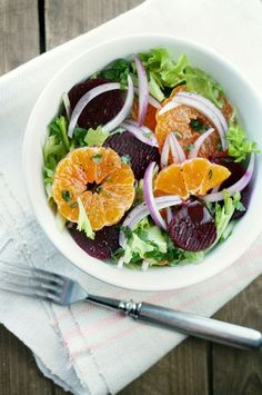 Ingredients (serves 4)  - 4 pickled red beets - 3 tangerines - 1 small red onion - 1 large punch of frisee lettuce  { dressing } - 3 tablespoons cranberry juice - 3 tablespoons extra-virgin olive oil - 1 tablespoon red wine vinegar  Slice pickled beets and peeled tangerines. Cut a small red onion into thin strips. Mix the dressing ingredients and pour some in a bowl full of lettuce. Toss until lightly coated. Add in sliced beets, tangerines and onion. Drizzle with a touch more dressing and serve.  { recipe inspiration from bon appetit }