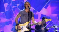 "Keith Urban is back atop the country radio mountain. The veteran artist's latest trip to #1 comes courtesy single ""John Cougar, John Deere, John 3:16."" The"