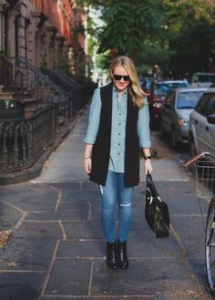 Wit and Whimsy tops off her double denim look with our long black double-breasted vest. The perfect piece to pull your fall outfit together   Banana Republic