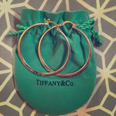 Tiffany & Co. Vintage Elsa Peretti Hoop earrings Here is a rare no-longer produced vintage pair of genuine solid Sterling silver 2 inch Tiffany & Co. Elsa Peretti hoop earrings. Beautiful. Comes with Blue Tiffany bag. Jewelry Earrings