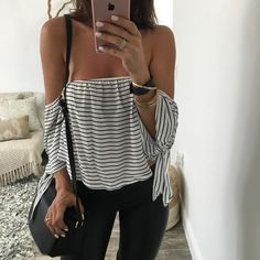 White and black striped off the shoulder top with sleeve ties. Cute and can be…