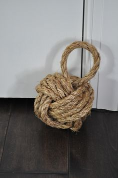 A tennis ball filled with sand or gravel and thick rope are the keys to this rope knot door stop.
