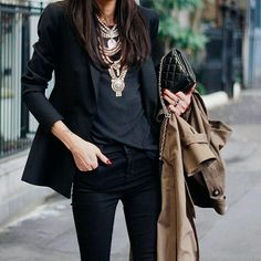 Fall Fashion with an oversized chunky layered statement necklace with a purse and classic trench in hand