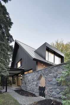 Amazing Tiny House: Closse Residence by NatureHumaineDesigned by NatureHumaine, this suburban home on Montreal's south shore was built by the father of our client in the After over 50 years w. Dormer Roof, Dormer Windows, Architecture Résidentielle, Vernacular Architecture, Design Exterior, House Extensions, Facade House, Beautiful Interiors, Building A House